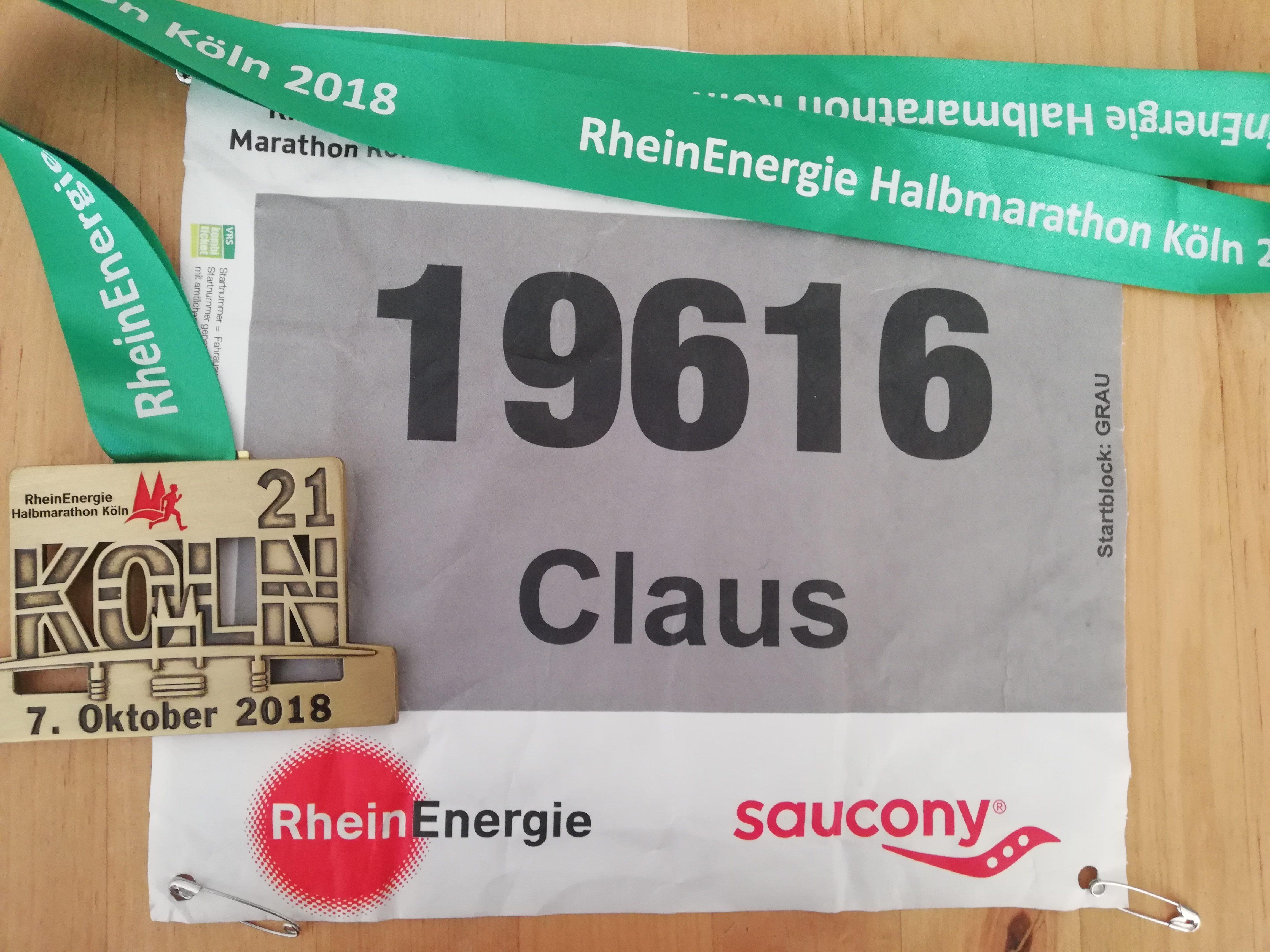 Finishermedallie und Startnummer RheinEnergie Halbmarathon Köln 2018